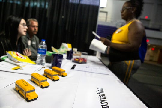 From left to right, Amy Little talks to Scarlett Moon and Chad Hitchcock, recruiters for A&S Transportation during a job fair at the Suncoast Credit Union Arena on Thursday, October 17, 2019, in Fort Myers.