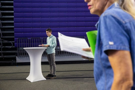 Wesley Kelchner, left, who is a senior high school student, works on his resume during a job fair at the Suncoast Credit Union Arena on Thursday, October 17, 2019, in Fort Myers.