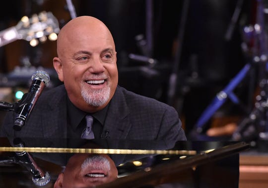 """Billy Joel has been making music since the 1960s, releasing popular albums throughout the 1970s, ?80s and ?90s.  Mike Coppola/NBC/Getty Images Billy Joel performed at Lambeau Field in 2017.  Mike Coppola/NBC/Getty Images for """"The Tonight ShOW"""" Billy Joel will be in concert June 17 at Lambeau Field."""
