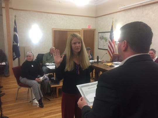 New council member Laura Mickelson is sworn-in by Village Law Director Mike King at the Oct. 16 council meeting.