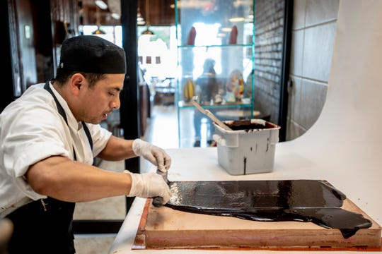 Rutilio Olivera, Executive Pastry Chef and Co-Owner of Sook Pastry in Ridgewood makes a Glen cake on Friday October 11, 2019.