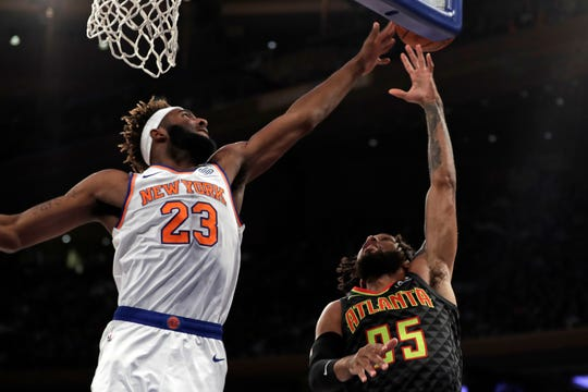 Oct 16, 2019; New York, NY, USA; Atlanta Hawks guard DeAndre' Bembry (95) has his shot blocked by New York Knicks center Mitchell Robinson (23) during the first half at Madison Square Garden.
