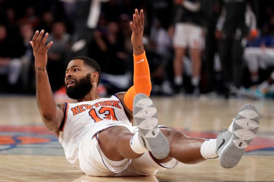 Oct 16, 2019; New York, NY, USA; New York Knicks forward Marcus Morris (13) reacts after missing a shot during the second half against the Atlanta Hawks at Madison Square Garden. Mandatory Credit: Adam Hunger-USA TODAY Sports
