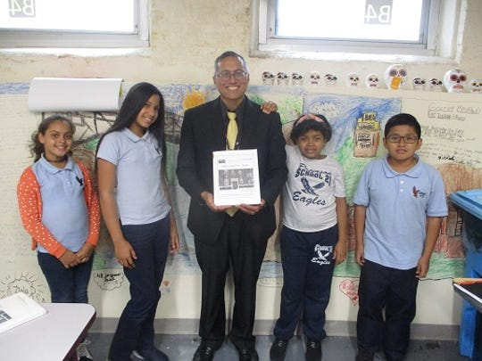 Paterson Public School 21 students (from left to right) Rosbely Balbuena, Noelis Acosta, Luz Reyes, and Italo Mestanza, with English as a Second Language Teacher Mr. Jason Velante.