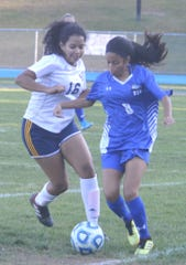 Hawthorne sophomore Mya Huerta (8) trying to control the ball with Eastern Christian senior Kimberly Abbas defending.