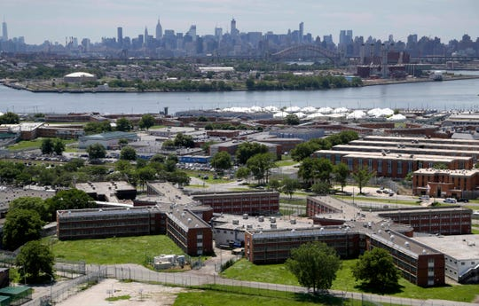 This June 20, 2014 file photo shows the Rikers Island jail complex in New York with the Manhattan skyline in the background.