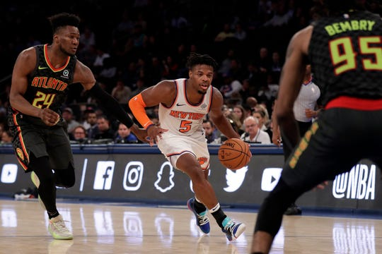 Oct 16, 2019; New York, NY, USA; New York Knicks guard Dennis Smith Jr. (5) drives to the basket past Atlanta Hawks forward Bruno Fernando (24) during the second half at Madison Square Garden. Mandatory Credit: Adam Hunger-USA TODAY Sports