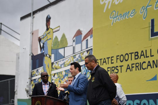 Mayor Andre Sayegh talks to the media as he unveils the new Larry Doby mural at Hinchliffe Stadium in Paterson on 10/17/19.