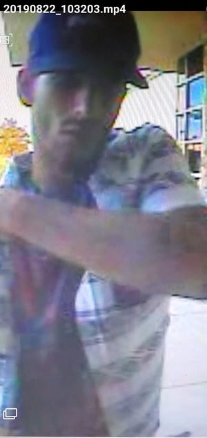 A photo of an alleged debit thief trying to take money in July from an ATM in the 100 block of N. Canal Street.