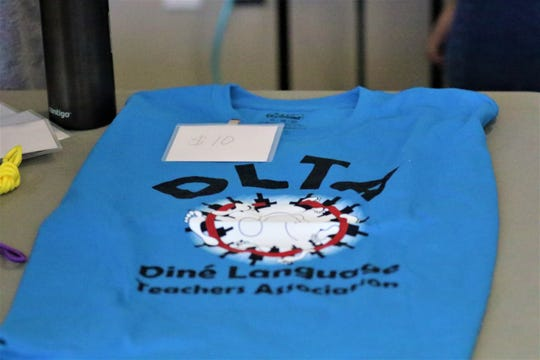 A Diné Language Teachers Association T-shirt was on sale at the association's conference in Farmington on Oct. 17, 2019.