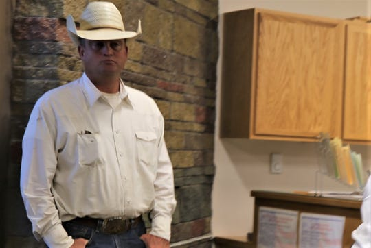 Cash Carruth stands in the San Juan County Clerk's Office after filing his paperwork in August.