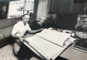Developer Fillmore Crank and actress Beverly Garland looking over some building plans in a family photo displayed at the dedication of a home built for them in Indian Wells on Oct. 14, 2019. The home, at 75900 Fairway Drive, was built in the early 1960s and designed by architect William F. Cody to be the show place for the new Desert Bel-Air Estates, across from Eldorado Country Club.