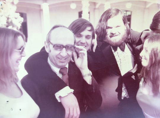 Dr. John Norman (second from left) and John Shoemaker (second from right)