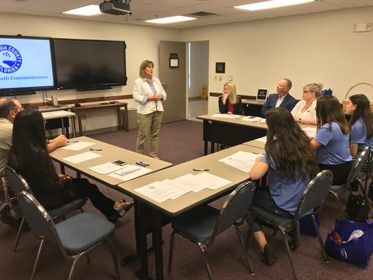 Escambia County Administrator Janice GIlley talks to members of the Escambia County Youth Commission.