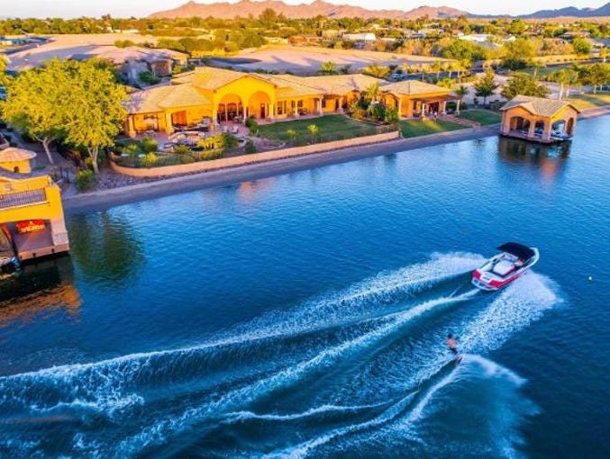 The $2.35M estate, sold by Jay and Rebecca Feely, features a guest house and a private covered boat dock.