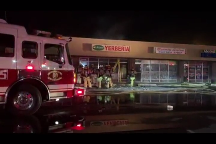 2 stores in Phoenix strip mall burned after fire spreads from shed, officials say