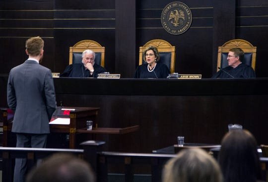 Assistant Attorney General Terry M. Crist (left) delivers an oral argument that prosecutorial misconduct should not overturn the conviction in the Jodi Arias murder trial.  Arizona Court of Appeals judges Kenton Jones (left)  Jennifer B. Campbell and Michael Brown listen in Phoenix on Thursday, Oct. 17, 2019.