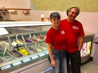 Heaven on a Spoon owners Erika and Gerard Lombardo pose for a photo in their gelato shop.