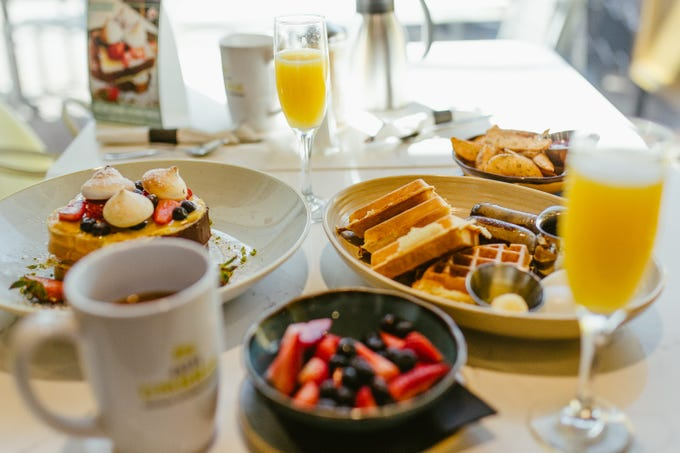 OEB Breakfast Co.'s menu features a range of dishes from simple farm-fresh classics and popular breakfast favorites to hearty poutine and benedicts.
