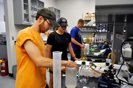 Students at the Ohio State University's Stone Laboratory on Gibraltar Island study water samples from Lake Erie.