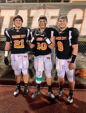 Brothers Wyatt, Mason and Colby Walker have led the Marine City football team to an undefeated start this season.