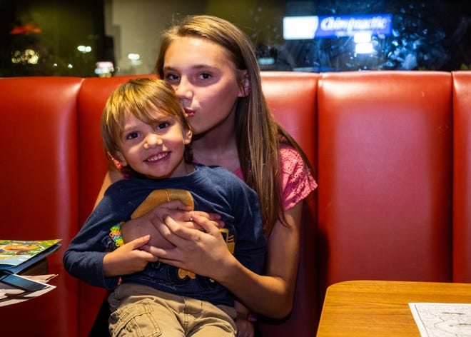 Mallory Milhoan, 12, poses for a photo with her brother Drake Manning, 3, Wednesday, Oct. 16, 2019, at Denny's in Fort Gratiot.