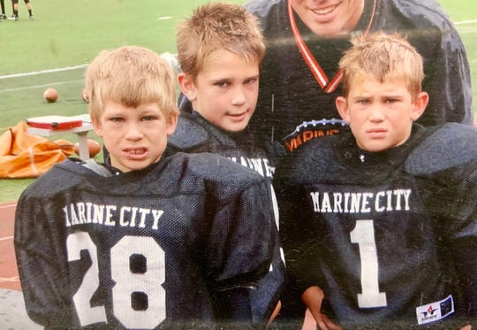 Brothers Wyatt, Colby and Mason Walker have grown up playing in the Marine City football system.