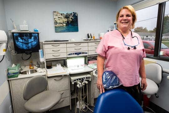 Dr. Paulette Bass poses for a photo in her Port Huron office Wednesday, Oct. 16, 2019. Dr. Bass has been practicing dentistry in Port Huron for 25 years.