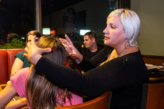 Malinda Evans, right, talks about an operation her daughter Mallory Milhoan, 12, will be receiving for her scoliosis.