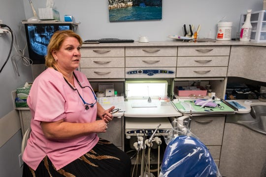 Dr. Paulette Bass talks in one of the exam rooms in her Port Huron dentistry office Wednesday, Oct. 16, 2019. Dr. Bass is celebrating practicing dentistry in Port Huron for 25 years.