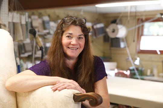 Deborah Loos, owner of Deb's Slipcovers and Upholstery, at her shop in Hyde Park on October 10, 2019.