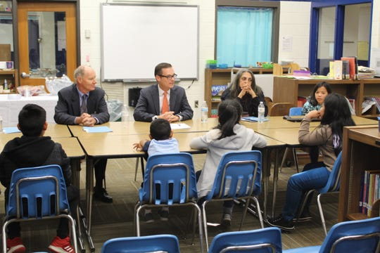 Jose Viana, assistant deputy secretary for the Office of Language Acquisition in the U.S. Department of Education (center) speaks with a group of English language learners at Thaddeus Stevens Elementary on Thursday, Oct. 17, 2019.