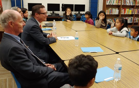 José A. Viana, U.S. Department of Education Office of English Language Acquisition Assistant Deputy Secretary, (second from left) speaks with fourth-grader Minh Troung (second student from right) while talking to a small group of English language learners during a visit to Thaddeus Stevens Elementary, Chambersburg, on Thursday, Oct. 17, 2019.