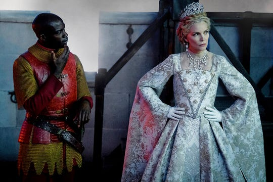 """David Gyasi, left, and Michelle Pfeiffer star in """"Maleficent: Mistress of Evil."""" The movie is playing at Regal West Manchester, Frank Theatres Queensgate Stadium 13 and R/C Hanover Movies."""