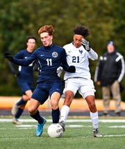 Dallastown's Matteo Conigliaro, left, and West York's Elijah Brown battle to control the ball during YAIAA boys' semifinal soccer action at Northeastern Senior High School in Manchester, Thursday, Oct. 17, 2019. Dallastown would win the game 2-1. Dawn J. Sagert photo