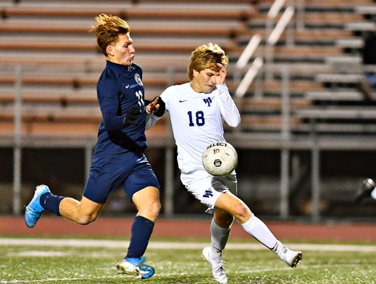 Dallastown's Matteo Conigliaro, left, and West York's Gavin Smyser battle to control the ball during YAIAA boys' semifinal soccer action at Northeastern Senior High School in Manchester, Thursday, Oct. 17, 2019. Dallastown would win the game 2-1. Dawn J. Sagert photo