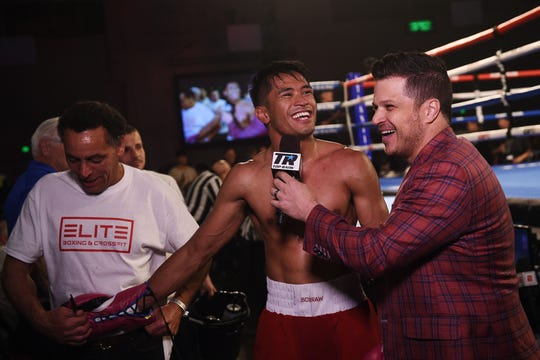 Reno's J.J. Mariano gets interviewed after defeating William Flenoy by way of TKO during a Top Rank boxing event at the Reno-Sparks Convention Center on June 8, 2019.