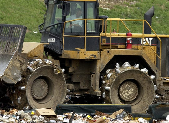 A compactor smashes down trash at the Richmond landfill in this file photo.