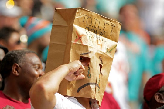A Miami Dolphins fan wears a paper bag over his head during a football game against the Washington Redskins at Hard Rock Stadium earlier this season.