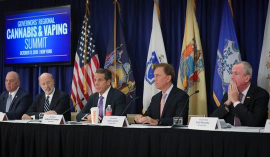 Pennsylvania Gov. Tom Wolf, second from left, New York Gov. Andrew Cuomo, center, Connecticut Gov. Ned Lamont, second from right, and New Jersey Gov. Phil Murphy, far right, co-host a regional summit on public health issues around cannabis and vaping, Thursday Oct. 17, 2019, in New York.