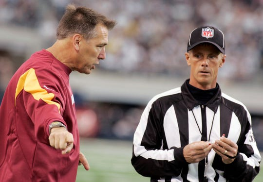 Rochester's Jim DeBell, a former NFL official, shown here in 2009 getting chewed out by Redskins coach Jim Zorn.