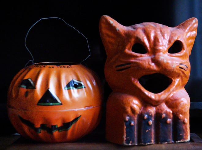 These vintage tin Jack O' Lantern and paper m‰chŽ cat were the first Halloween items in Deborah Hughes collection.