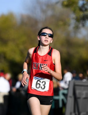 Brandon Valley's Mia Wentzy finishes in second place during the Metro Conference cross country meet on Thursday, Oct. 17, 2019 at Yankton Trail Park.
