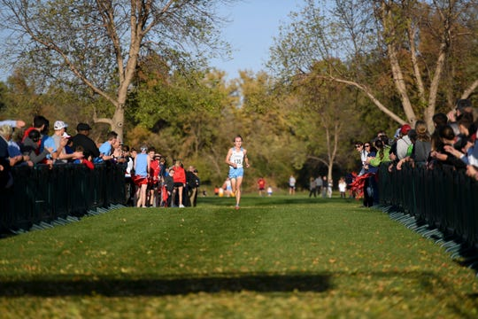 Lincoln's Andrew Lauer finishes in first place during the Metro Conference cross country meet on Thursday, Oct. 17, 2019 at Yankton Trail Park.
