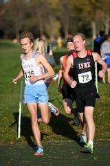 Lincoln's Andrew Lauer leads during the Metro Conference cross country meet on Thursday, Oct. 17, 2019 at Yankton Trail Park.
