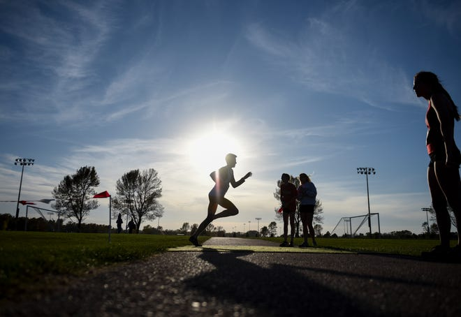 The sun sets during the Metro Conference cross country meet on Thursday, Oct. 17, 2019 at Yankton Trail Park.