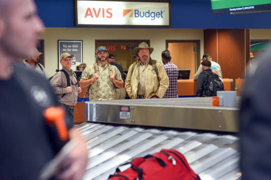Hunters arrive at the Sioux Falls Regional Airport to take part in the upcoming pheasant hunt on Thursday, October 17.
