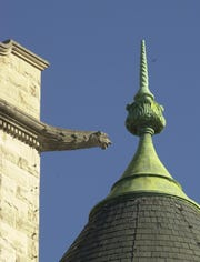 Four gargoyles, which serve as water spouts, are atop Historic City Hall.
