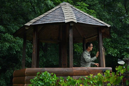 Drew Miller stands in a treehouse at Fortitude Ranch, a survivalist camp in West Virginia. If there were a breakdown in society, the treehouse would become a guard tower.