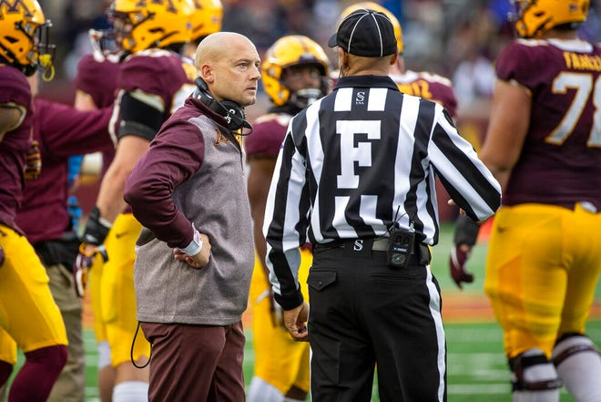 Minnesota head coach P.J. Fleck listens to an official against Illinois Oct. 5, 2019. The Gopher coach could likely receive a contract extension given his recent success.